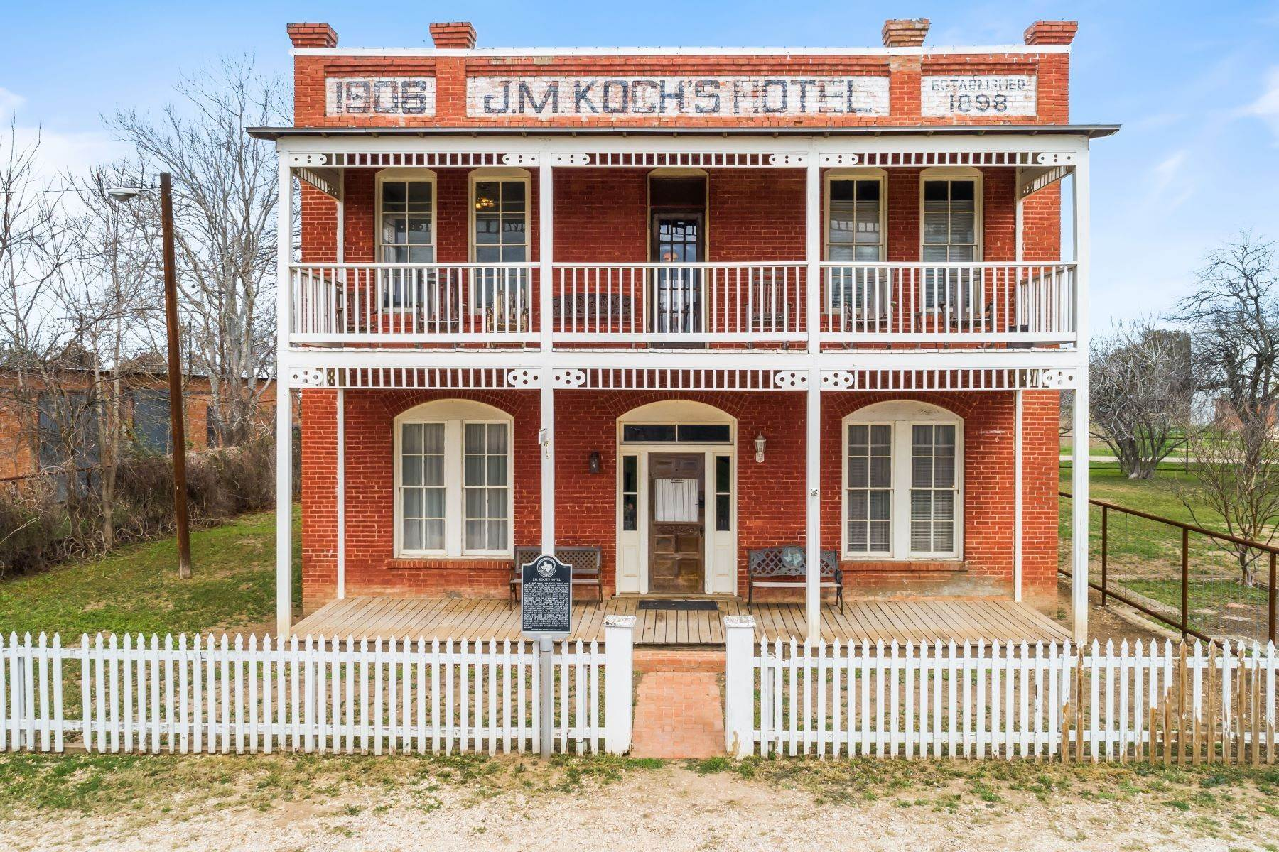Single Family Homes for Sale at Historic J.M. Koch's Hotel 7254 County Road 525 D Hanis, Texas 78850 United States